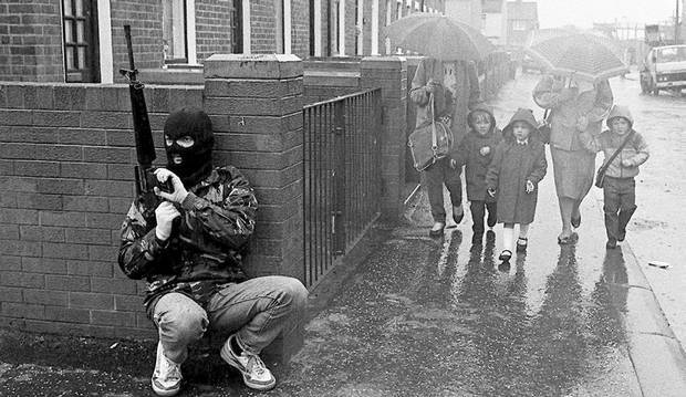 A Belfast man on patrol for the Irish Republican Army, 1987. Pacemaker Press International/Belfast Telegraph Archive