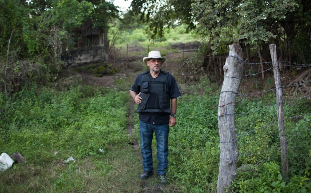 """Hipolito Mora at his families lime ranch in La Ruana, Michoacán, Mexico, Tuesday, December 15, 2015. Hipolito Mora was one of the original founder of the autodefensa movement, which saw vigilantes spread across the state of Michoacán and drive out the cartel group the 'Knights of Templar'. Since the uprising began in 2013, other criminal groups have filled the space of the previous cartel and many look at the autodefensa movement as a failure. Mora has had many challenges over the last three years, including being sent to jail twice and having his son killed in a shootout Dec. 16, 2014 during a shootout with a rival group. This ranch is a very important place for Mora. """"This is where I expect to die"""" said Mora, motioning to the hills surrounding the ranch, which would make for a great spot for a shooter to hide. """"My son and I had plans to build up the house and make this out place, it was out dream, but that was before."""" (Brett Gundlock/Boreal Collective)"""