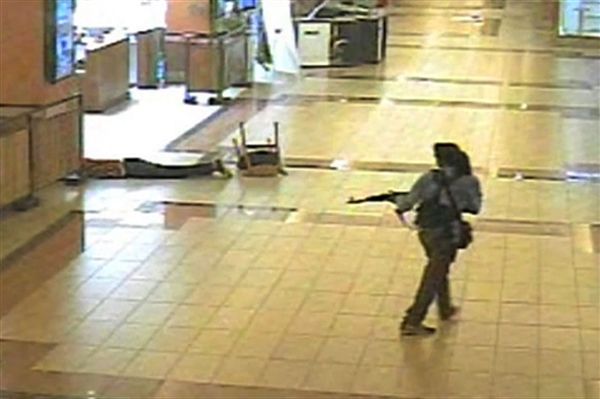 A Terrorist takes aim at civilians during the Westgate Shopping Mall Attack in Kenya in 2013.